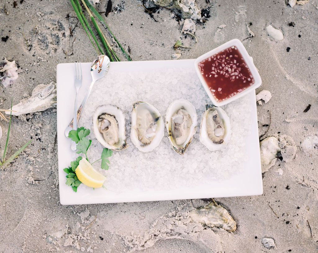 Shucked oysters with sauce